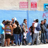 An August 15, 2012 file photo shows young people waiting in line to enter the Coalition for Humane Immigrant Rights of Los Angeles (CHIRLA) office in California, on the first day of the Deferred Action for Childhood Arrivals (DACA) program. As part of a deal to win conservative votes on a $659 million border funding bill this week, House GOP lawmakers are reportedly debating a provision that would block the program, which since 2012 has allowed certain young immigrants to obtain temporary legal status.