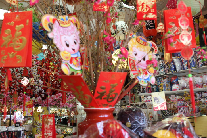 Customers shop at Wing Wa Hing Gifts and Arts, Inc. in downtown Los Angeles' Chinatown.