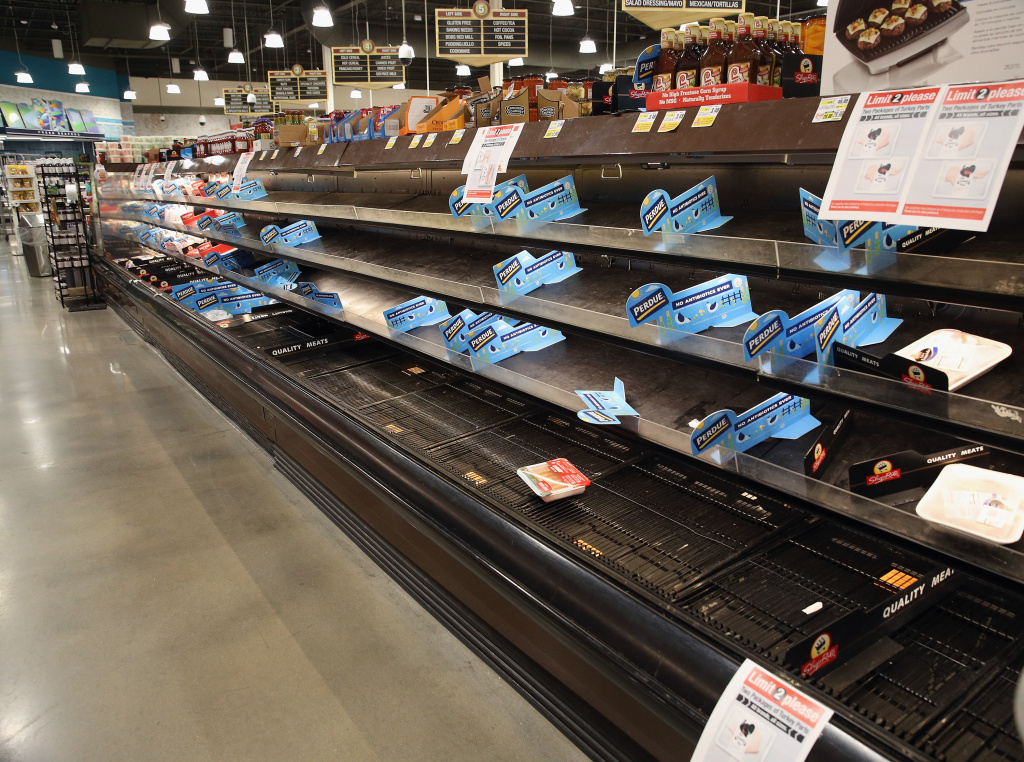 Shelves reserved for Perdue chicken lie empty at a supermarket in New York.