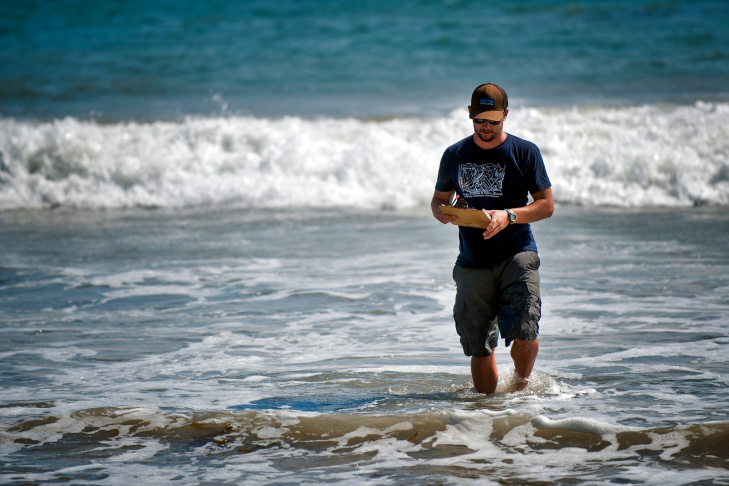 David Hubbard, a research specialist at UCSB's Marine Science Institute, looks for crustaceans called isopods on a Malibu beach on July 24. Hubbard and a group of scientists have found that the population of two species of isopods has disappeared from 60 percent of Southern California beaches.