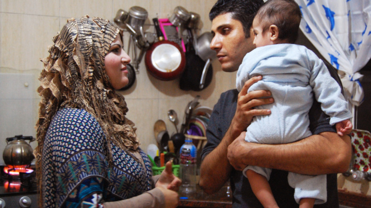 "Ala'a Miqbel (shown here with his wife and their youngest son in their Gaza City apartment) was held for nearly four weeks in an Israeli prison, then released without charges. There, he met the ""sparrows"" — Palestinians who appear to be fellow prisoners b"