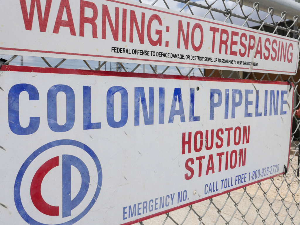 A sign at the Colonial Pipeline Houston Station facility in Pasadena, Texas, warns against trespassing. Colonial was forced to shut down a key pipeline last month after suffering a ransomware attack. Such attacks are becoming more frequent and increasingly, they are targeting key infrastructure like fuel or food supplies.
