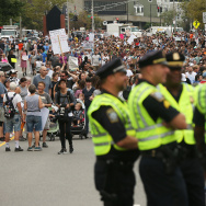 Police stand by as thousands of protesters prepare to march in Boston against a planned 'Free Speech Rally' just one week after the violent 'Unite the Right' rally in Virginia