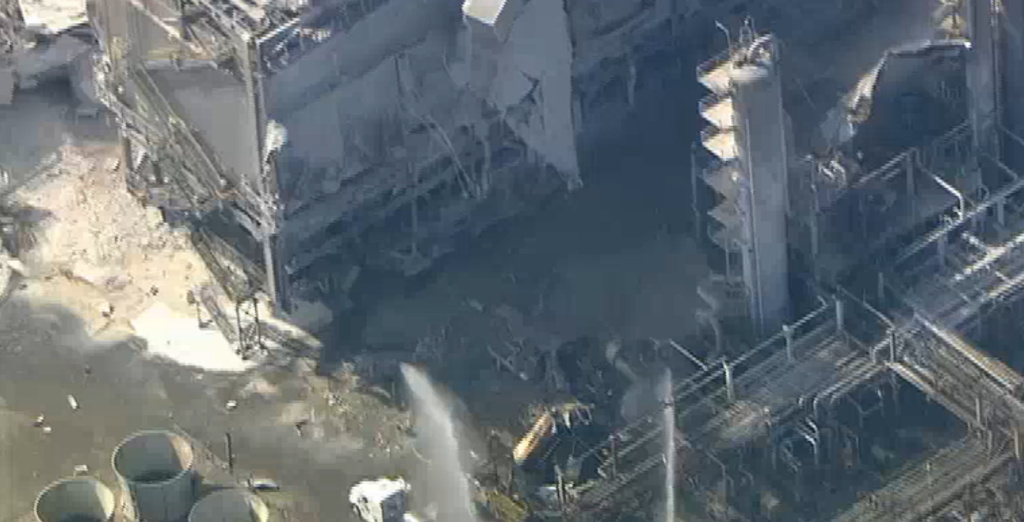 Aerial footage from NBC4 shows firefighters responding to the scene of an explosion at the ExxonMobil refinery in Torrance on February 18, 2015.