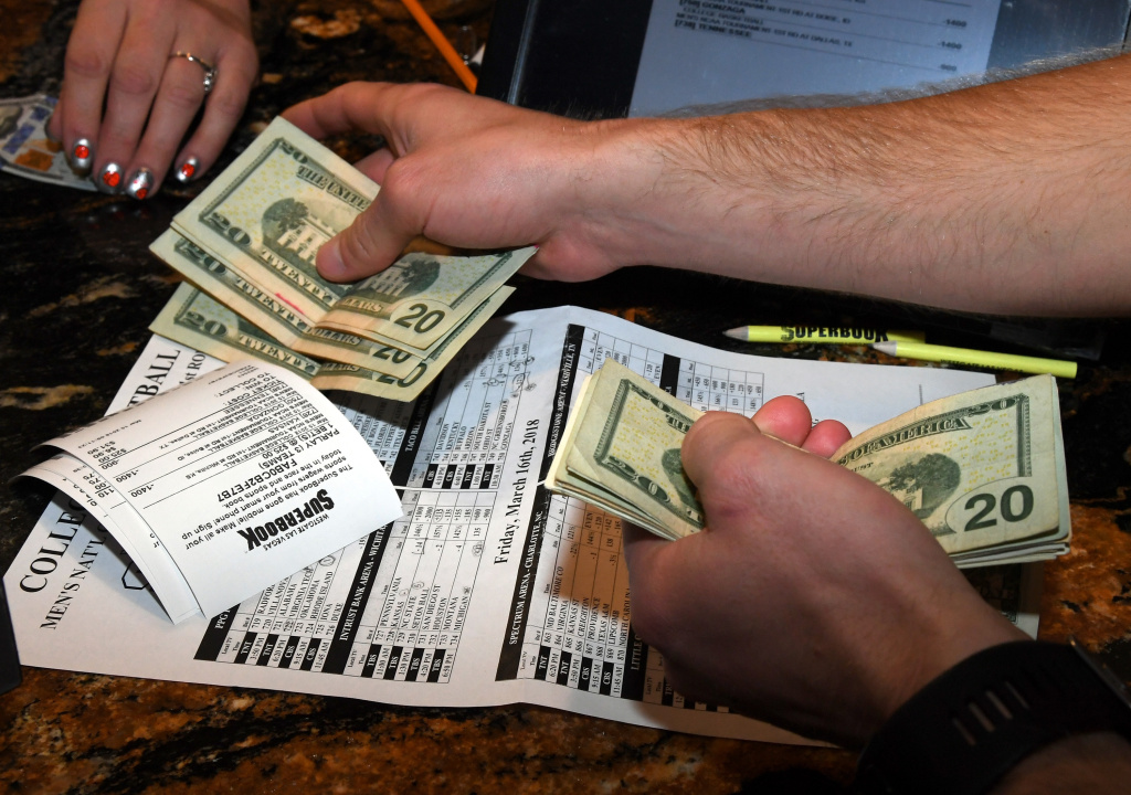 Jake Sindberg of Wisconsin makes bets during a viewing party for the NCAA Men's College Basketball Tournament inside the 25,000-square-foot Race & Sports SuperBook at the Westgate Las Vegas Resort & Casino which features 4,488-square-feet of HD video screens on March 15, 2018 in Las Vegas, Nevada.