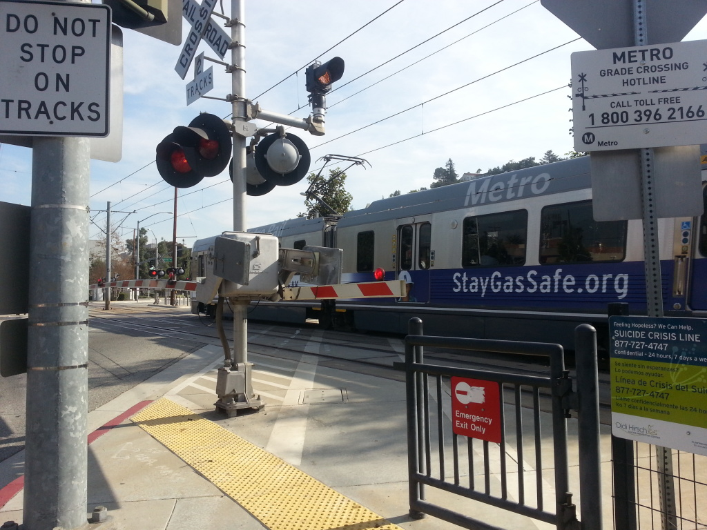 In this file photo, a Metro Gold Line train passes through an intersection in South Pasadena. A Gold Line train struck a car in Pasadena Wednesday morning. The accident has been cleared, but commuters were warned to expect delays.
