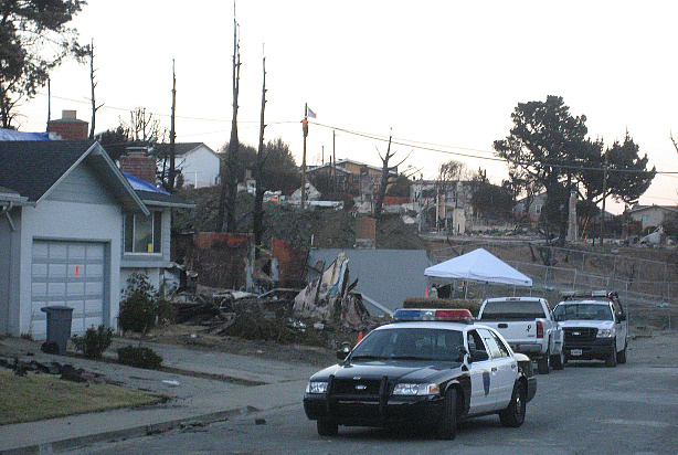 A patrol car is stationed in the Glenview neighborhood of San Bruno, Calif. File photo.