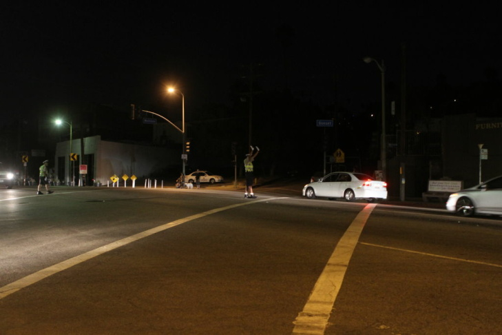 A Traffic officer keeps the intersection of Sunset and Maltman safe during Silver Lake's second power outage of the day.