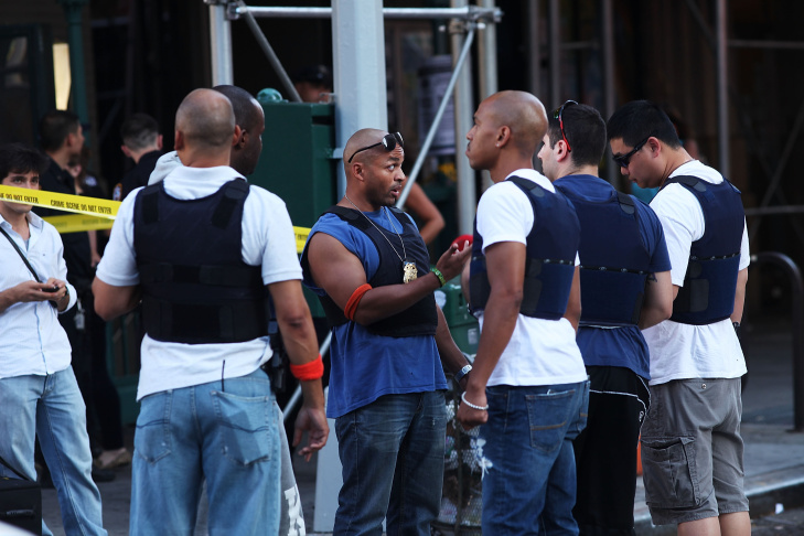 Police arrive at the scene in lower Manhattan where two people were shot at the Federal Immigration Court on August 21, 2015 in New York City. One man was killed and another injured in the late afternoon shooting.