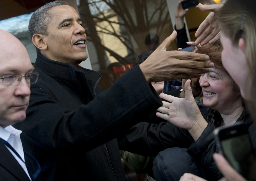 US President Barack Obama greets wellwishers during a shopping trip to One More Page Books on Small Business Saturday, which promotes shopping at local small businesses, in the Falls Church neighborhood of Arlington, Virginia, on November 24, 2012.