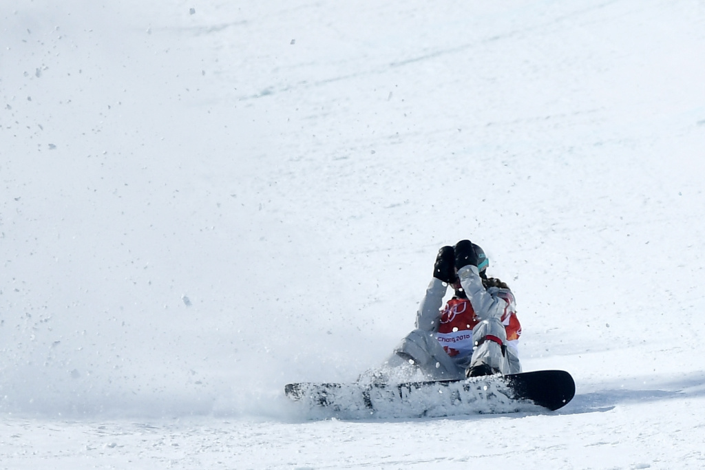Maddie Mastro of the United States wipes out in the Snowboard Ladies' Halfpipe Final at the PyeongChang 2018 Winter Olympic Games on February 13, 2018.
