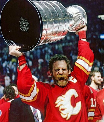 Calgary Flames forward Lanny McDonald hoisting the Stanley Cup in 1989. Readers of the UK's Globe and Mail voted Lanny's playoff beard the best of all time.