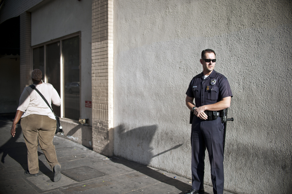 LAPD Officer William Allen does a foot patrol in Skid Row on Jan. 22.