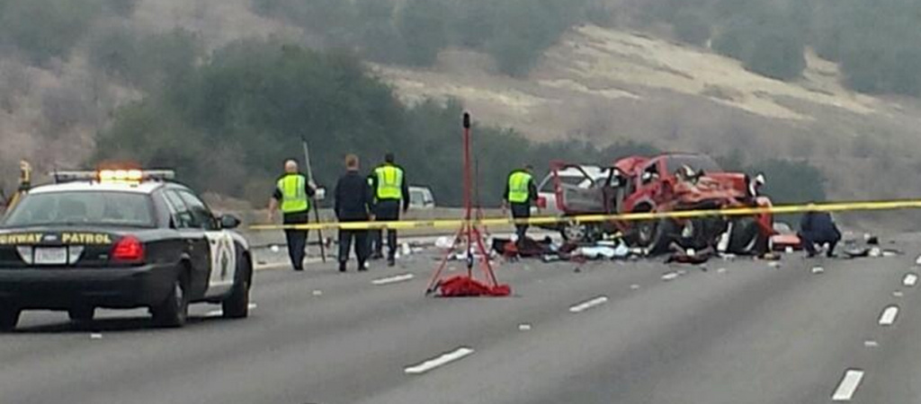 California Highway Patrol investigators at the scene of a crash that left six people dead and hurt two others.