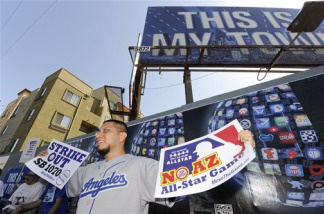 John Morales protests Arizona's crackdown on illegal immigration, outside Dodger Stadium before the Los Angeles Dodgers' baseball series with the Arizona Diamondbacks, Monday, May 31, 2010, in Los Angeles.