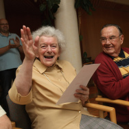 Maria Schoedel (L), sitting next to Hans Walter shows her delight after attending a Nintendo Wii bowling match at the Malhaelden seniors home.