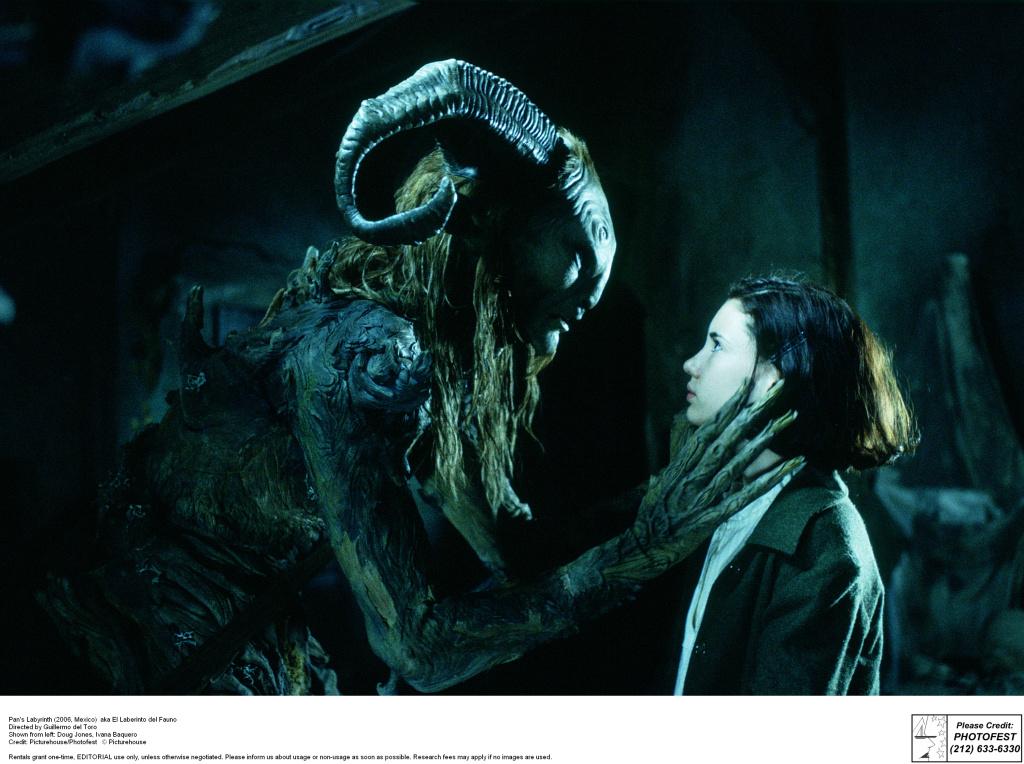 Pan's Labyrinth (2006, Mexico)  aka El Laberinto del Fauno Directed by Guillermo del Toro Shown from left: Doug Jones, Ivana Baquero