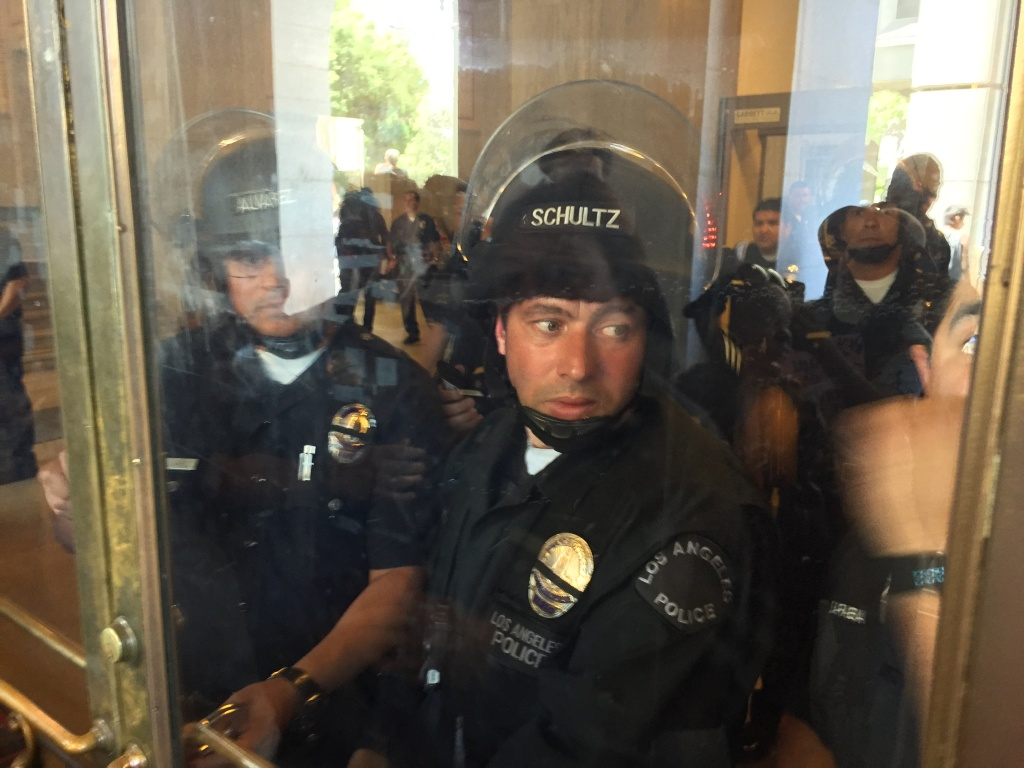 Police in riot gear keep protesters out of City Hall on Tuesday, July 12, 2016. The protesters marched from police headquarters to City Hall after the Board of Police Commissioners ruled that officers acted