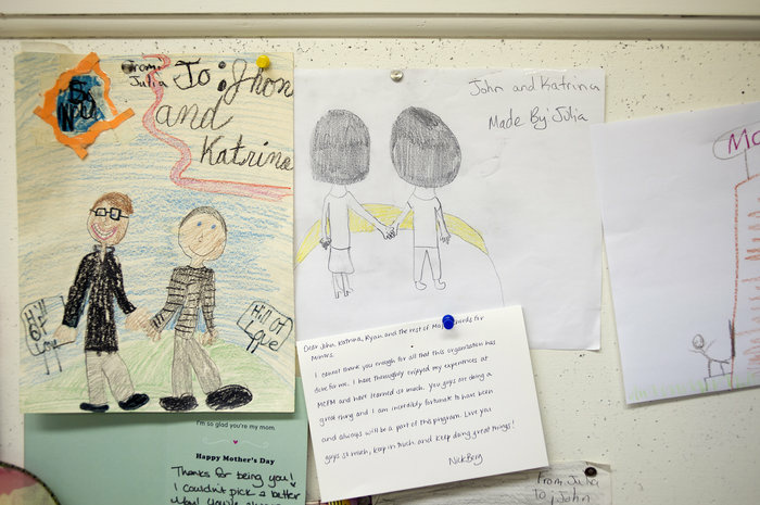 Thank-you notes and student drawings hang on the cork board surrounding the Major Chords for Minors office. Co-founders John and Katrina Vowell let the kids hang out in the office before and after their music lessons to color, talk or do homework.