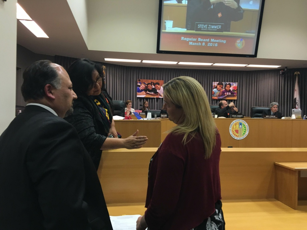 L.A. Unified school board member Mónica García (center) speaks with Shawna Draxton (right), executive director of WISH Charter Schools, as the head of the district's Charter Schools Division, José Cole-Gutiérrez, looks on during a meeting of the board on March 8, 2016. García was working on a motion to overrule district staff and grant WISH's application to open a new charter school despite the misgivings of Cole-Gutiérrez and other board members.