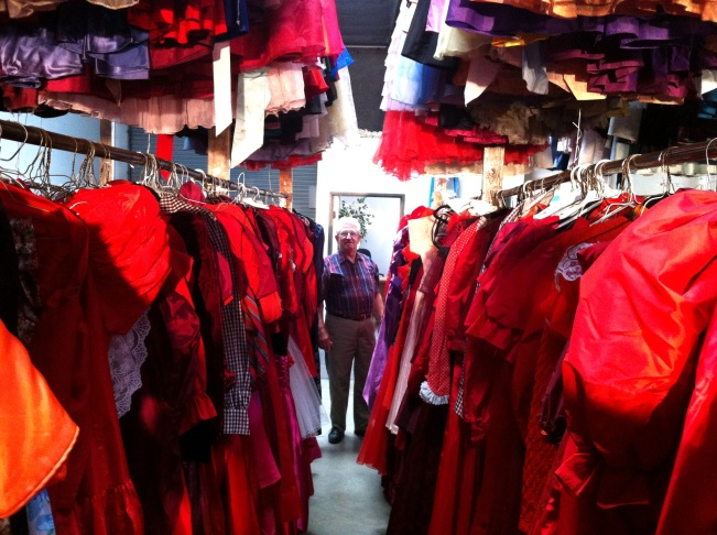 Paul Brockmann among just a few of the 55,000 dresses he's collected over 50 years. He loves the sound of taffeta.