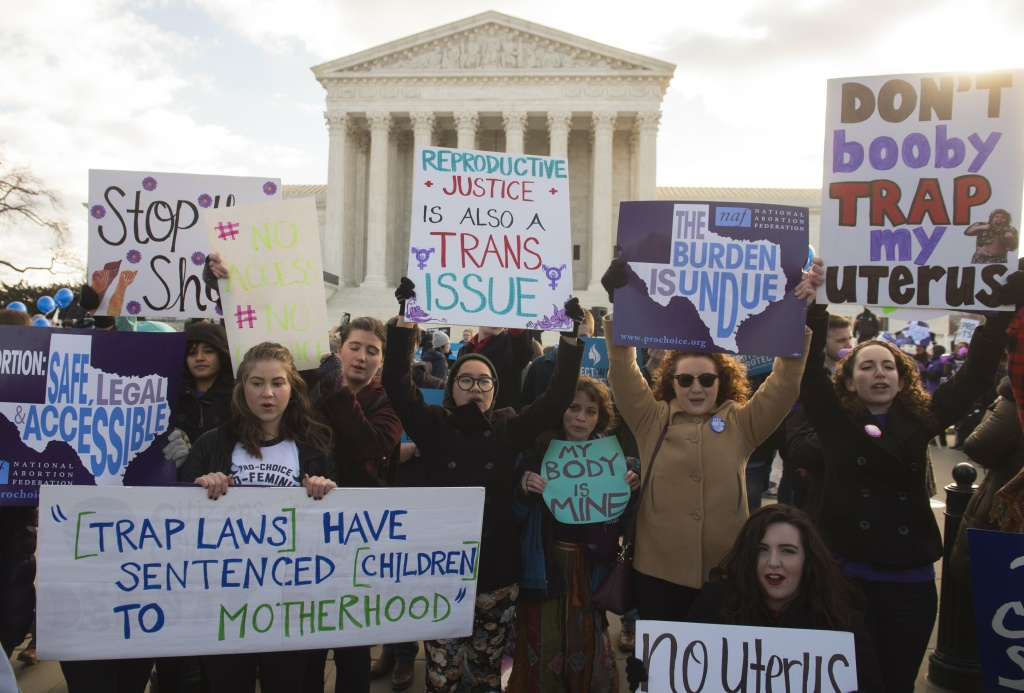 Supporters of legal access to abortion, as well as anti-abortion activists, rally outside the Supreme Court as the Court hears oral arguments in the case of Whole Woman's Health v. Hellerstedt.
