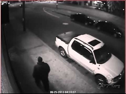 A surveillance camera captured video of a man who two LAPD officers believed targeted them. No suspect was ever arrested.
