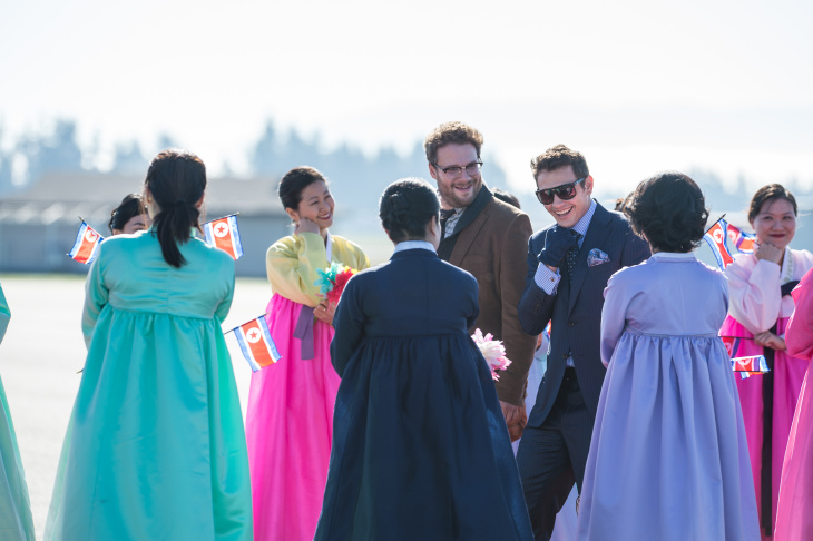 Seth Rogen and James Franco's characters arrive in North Korea to a welcoming crowd in Columbia Pictures'