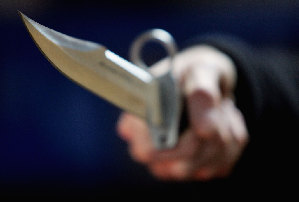 A hunting knife is held by an employee at a film and television prop company December 13, 2004 in London, England.