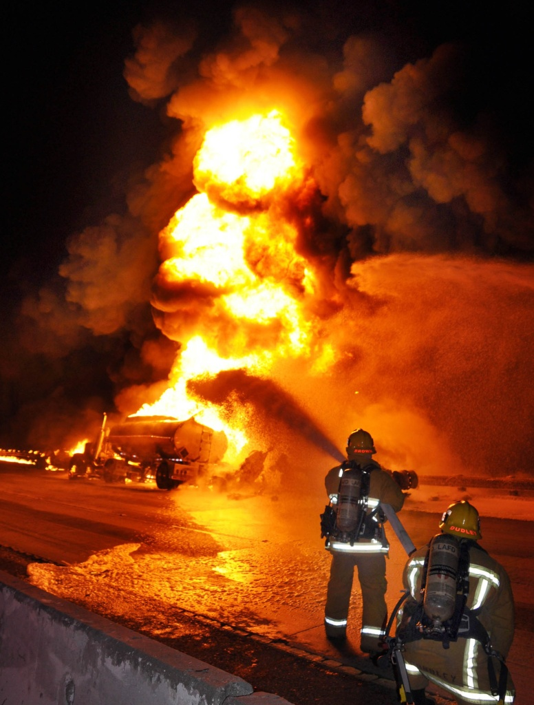 Firefighters use foam to extinguish a gasoline tanker fire in Glendale, Calif., Saturday, April 7, 2012. The California Highway Patrol reopened the eastbound 134 Freeway near where the gasoline tanker truck caught fire in a crash with a Honda sedan that sent flames and black smoke shooting into the air.