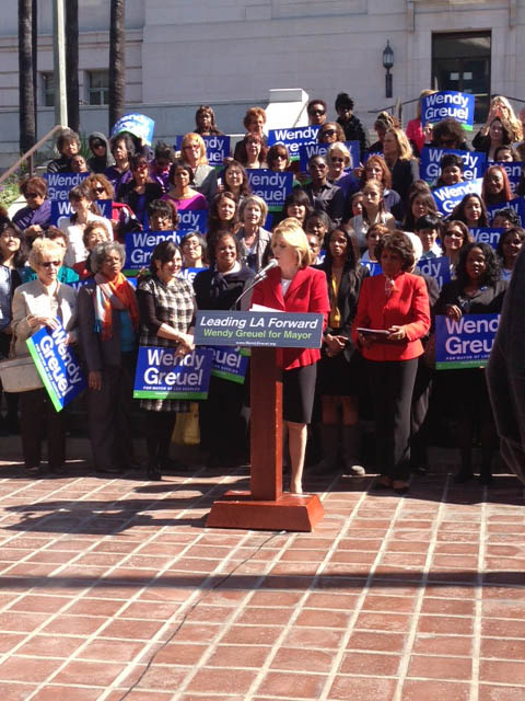 Wendy Greuel accepted the endorsement of Rep. Maxine Waters (behind Greuel in red jacket) outside of City Hall on Monday.