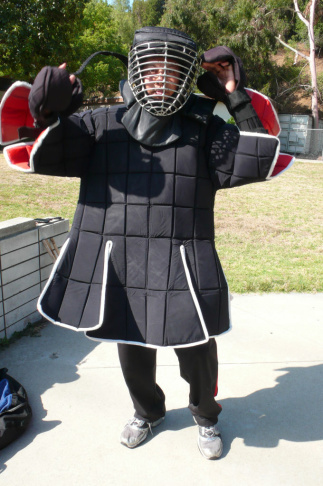 An eskrima martial artist dons his protective sparring gear