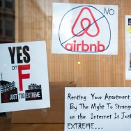 Signs showing support for Proposition F are posted on a shop window in San Francisco, California on November 2, 2015.