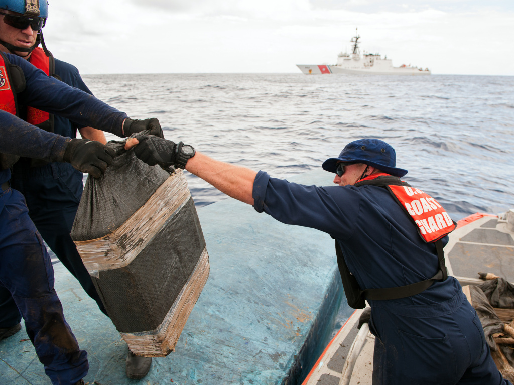In this July 19 photo released by the U.S. Coast Guard, a crew removes some of the 12,000 pounds of cocaine seized from a semi-submersible vessels in Pacific waters south of Mexico.