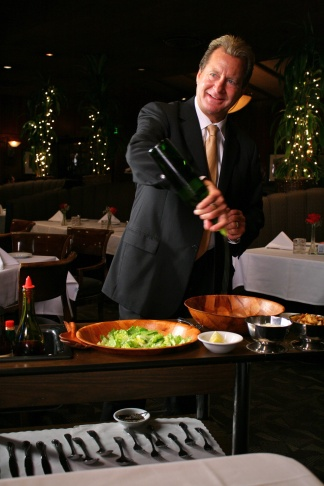 Dal Rae co-owner Lorin Smith preparing Caesar salad tableside