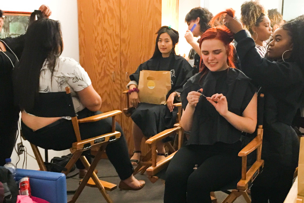 Young women in L.A. County's foster care program get their hair and makeup done before a presentation at Walt Disney Concert Hall to celebrate their graduating high school and being accepted to college.
