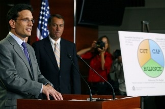 Majority Leader Eric Cantor (R-VA) (L) speaks while House Speaker John Boehner (R-OH) (C) listens during a news conference at the U.S. Capitol.