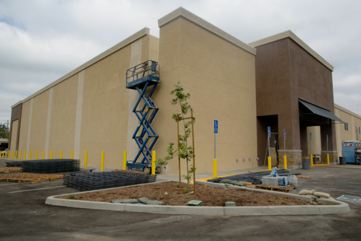Lorenzo Esteban grades the floor of the future 28,000-square-foot Walmart Neighborhood Market in Altadena, Calif.