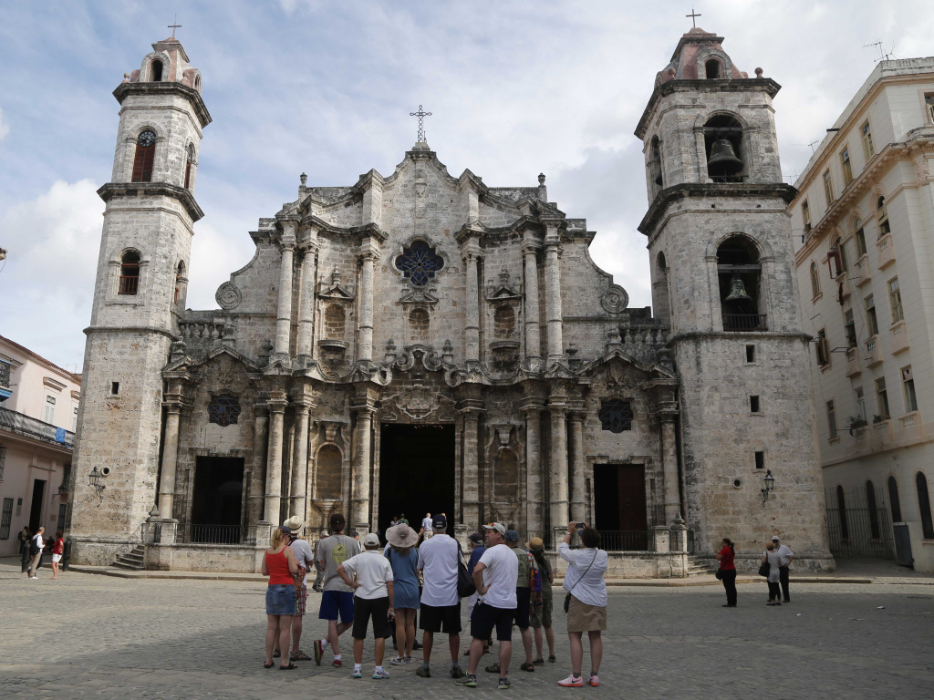 American tourists, like these visitors taking a guided tour in May, still have to provide one of 12 authorized reasons — such as visiting family or engaging in humanitarian work — for travel to Cuba.