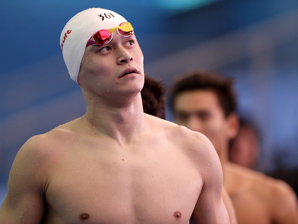 China's Sun Yang leaves the pool deck following the men's 4x200m freestyle relay heats at the World Swimming Championships in Gwangju, South Korea, in 2019.