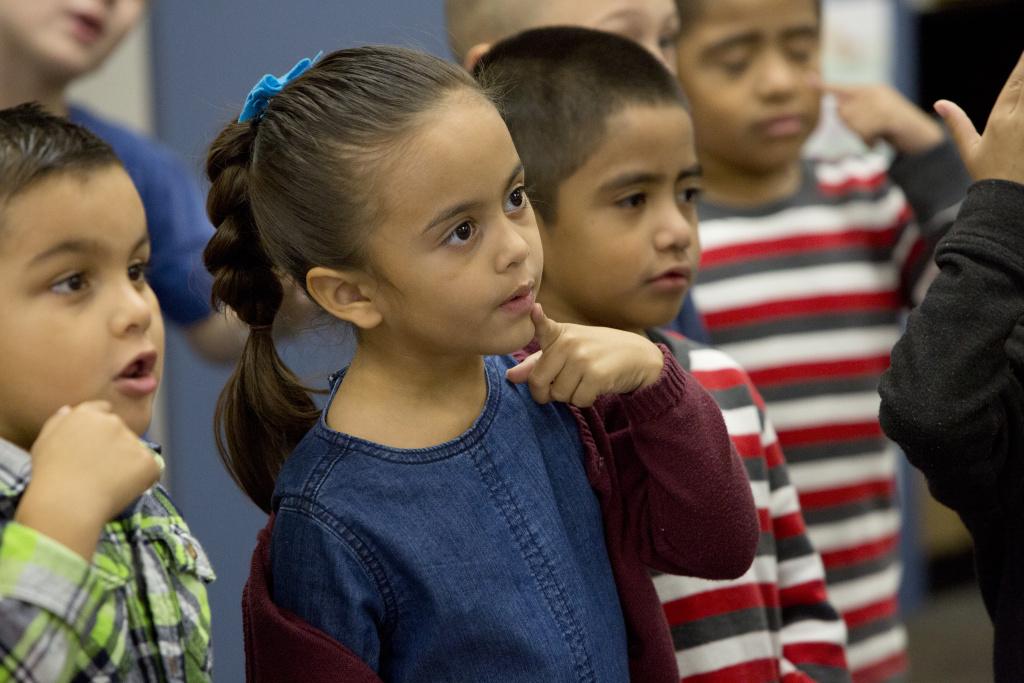 Lily De Dios sings with her classmates in Ron Morris' kindergarten class.