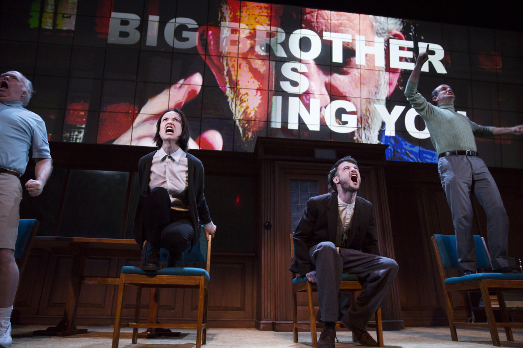 "Olivia Wilde, and Tom Sturridge (seated) and the cast of Broadway's ""1984."""