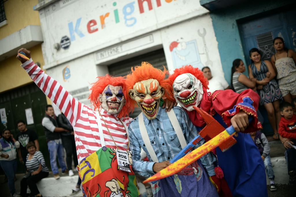 Revelers dressed as clowns take part in the traditional