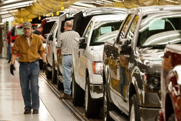 The Labor Department Wednesday reports that U.S. worker productivity grew a modest amount from January through March after having declined in the previous quarter. (Photo: Ford Motor Co. F-150 trucks move along the Kansas City, Mo. assembly line in May 2013.   Photo by Kevin Anderson/Bloomberg via Getty Images).