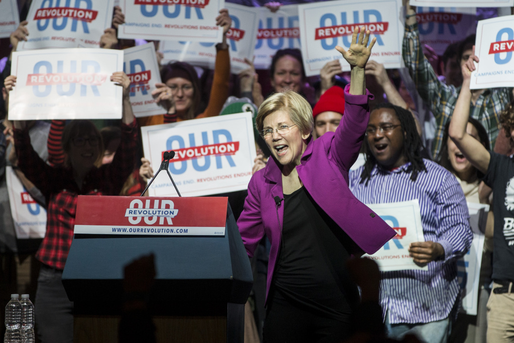 Senator Elizabeth Warren (D-MA) waves as she enters the Our Revolution Massachusetts Rally at the Orpheum Theatre on March 31, 2017 in Boston, Massachusetts.