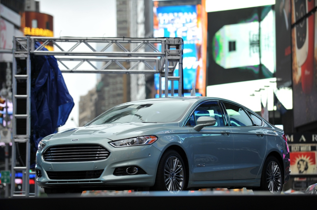 The 2013 Ford Fusion Hybrid at its introduction September 18, 2012 in New York's Times Square.