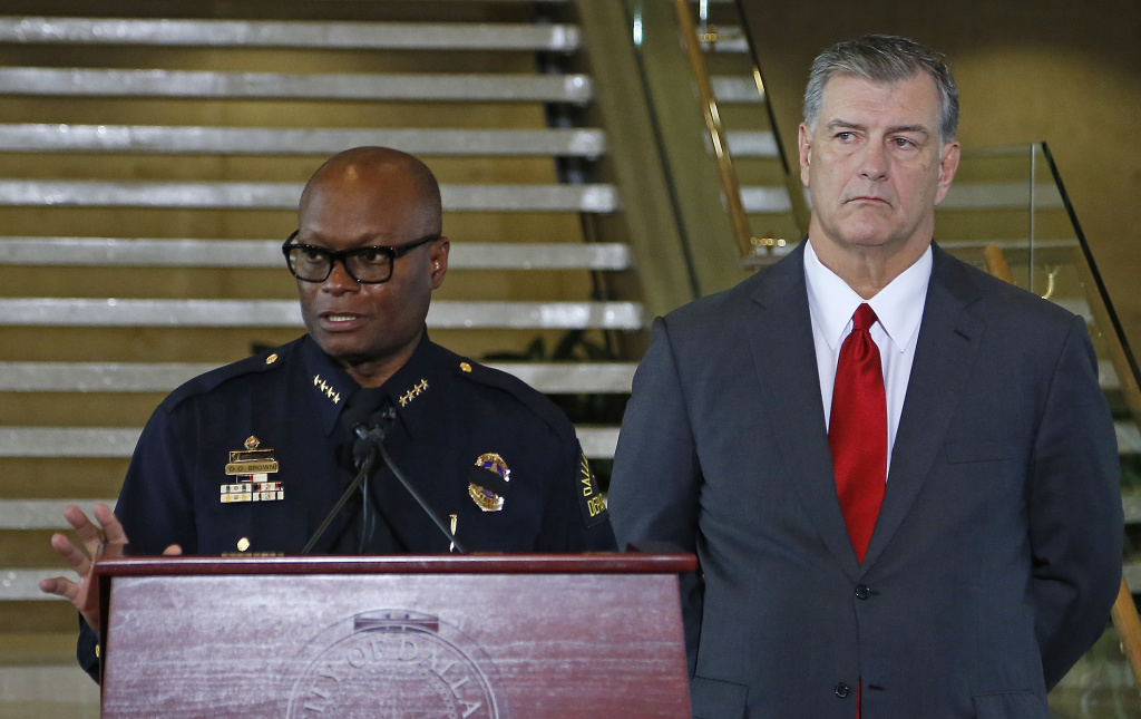 Dallas Mayor Mike Rawlings (R) looks on during a press conference at Dallas City Hall as Dallas Police Chief David Brown speaks on the fatal shootings of five police officers in Dallas, Texas.