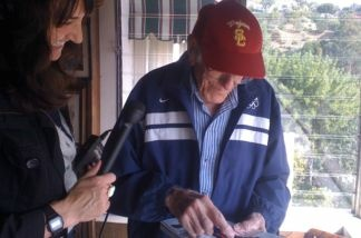 Louis Zamperini, Olympian and World War II survivor, right, with KPCC's Madeleine Brand.