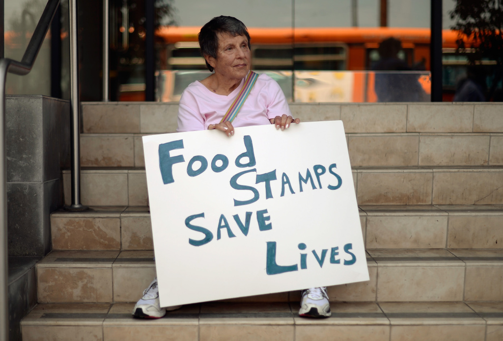 Members of Progressive Democrats of America and other activists hold a rally in front of Rep. Henry Waxman's office on June 17, 2013 in Los Angeles, California. The protestors were  asking the congressman to vote against a House farm bill that would reduce federal spending on the Supplemental Nutritional Assistance Program by $20.5 billion and affect food stamps and other services for the poor.