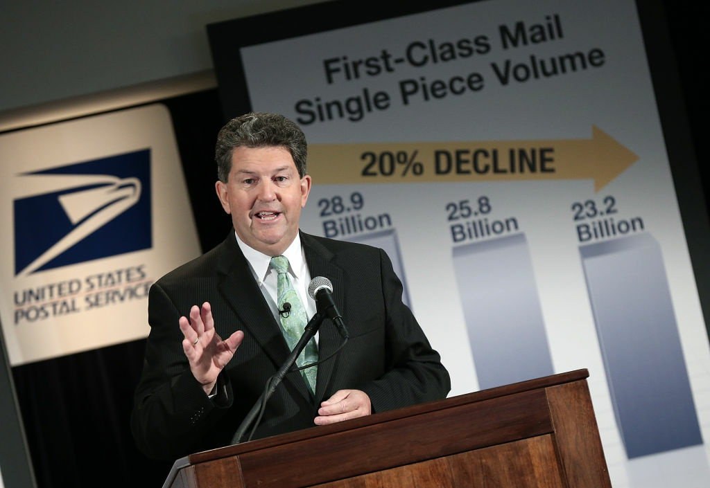 Postmaster General Patrick Donahoe speaks during a press conference at U.S. Postal Service headquarters February 6, 2013 in Washington, DC. The U.S. Postal Service will stop Saturday mail delivery beginning in August, but will still offer parcel delivery six days a week in a plan aimed at saving approximately $2 billion annually.